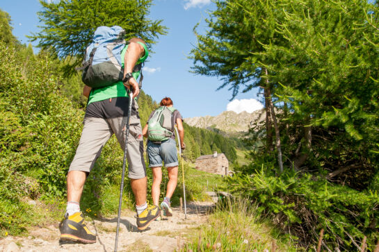 people walking outdoors on mountain trail